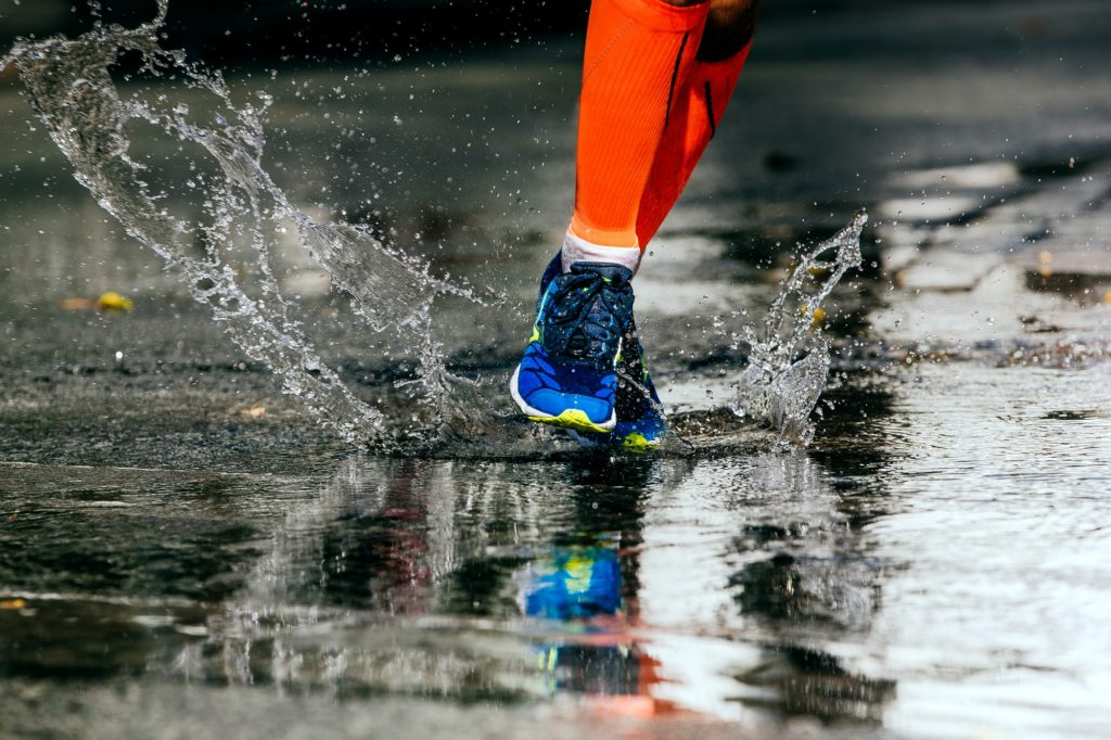 athlete runner run on puddle