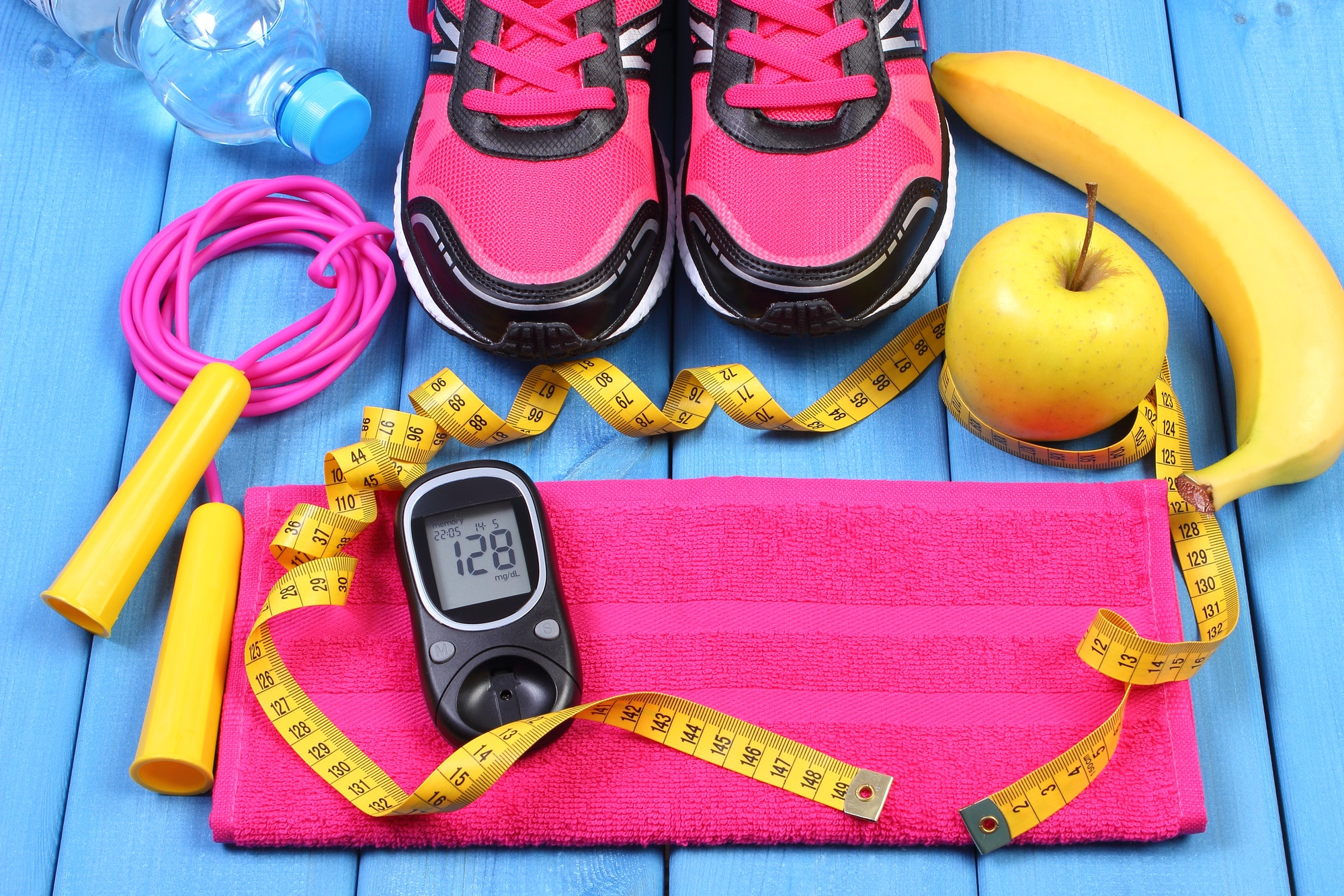 Glucometer, sport shoes, fresh fruits and accessories for fitness