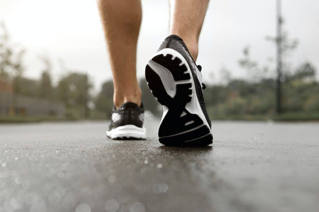 Jogger in sneakers outside