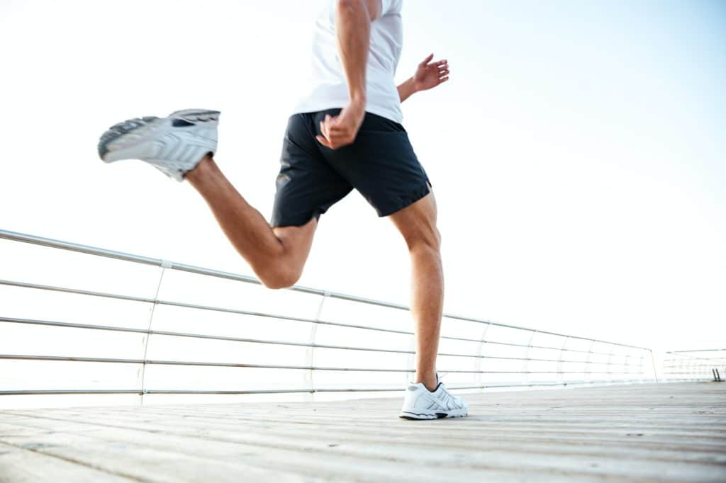 Cropped image of athlete runner's feet and shoes running