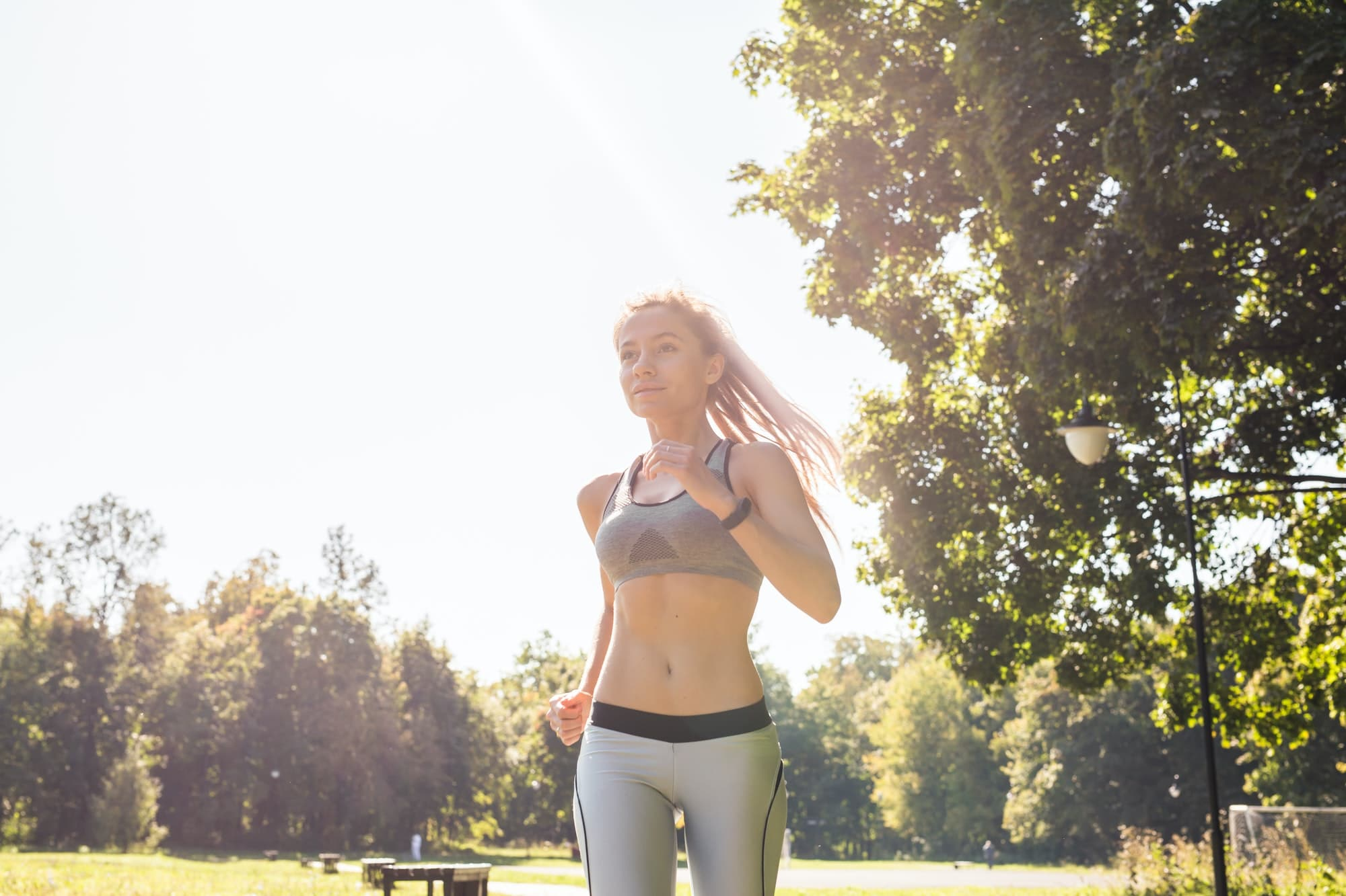 healthy lifestyle young fitness woman running outdoors