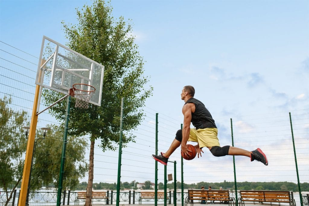 Basketball player makes a throw in jump, outdoor