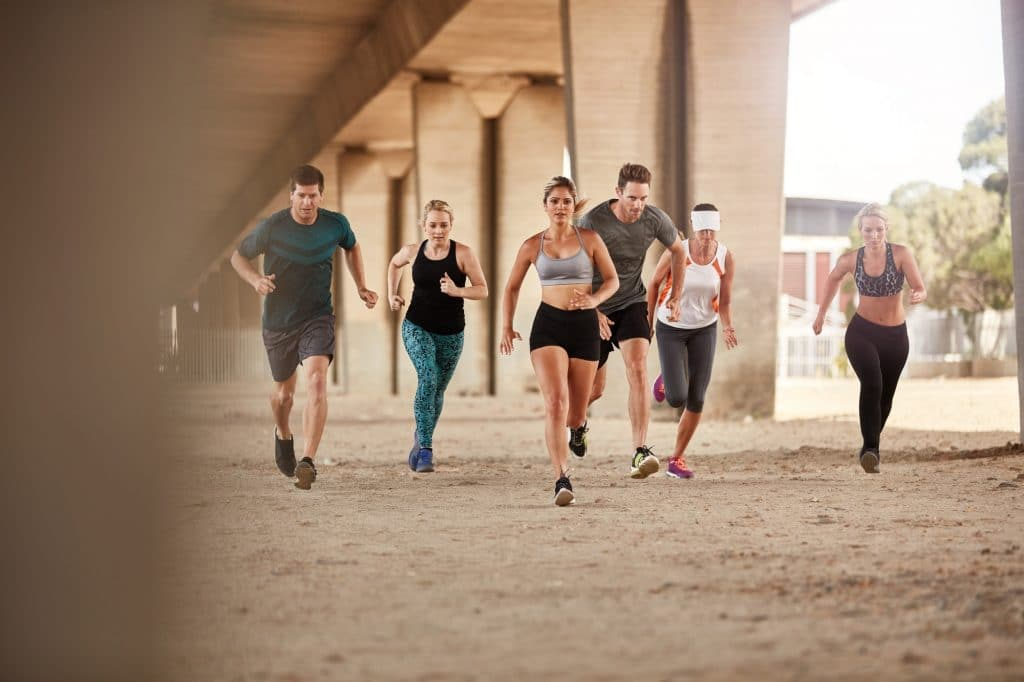 Group of runners training outdoors