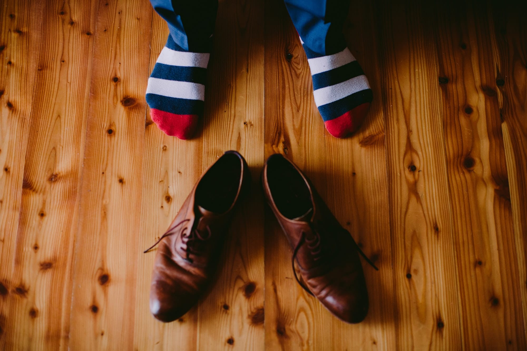 man wearing colourful socks and shoes