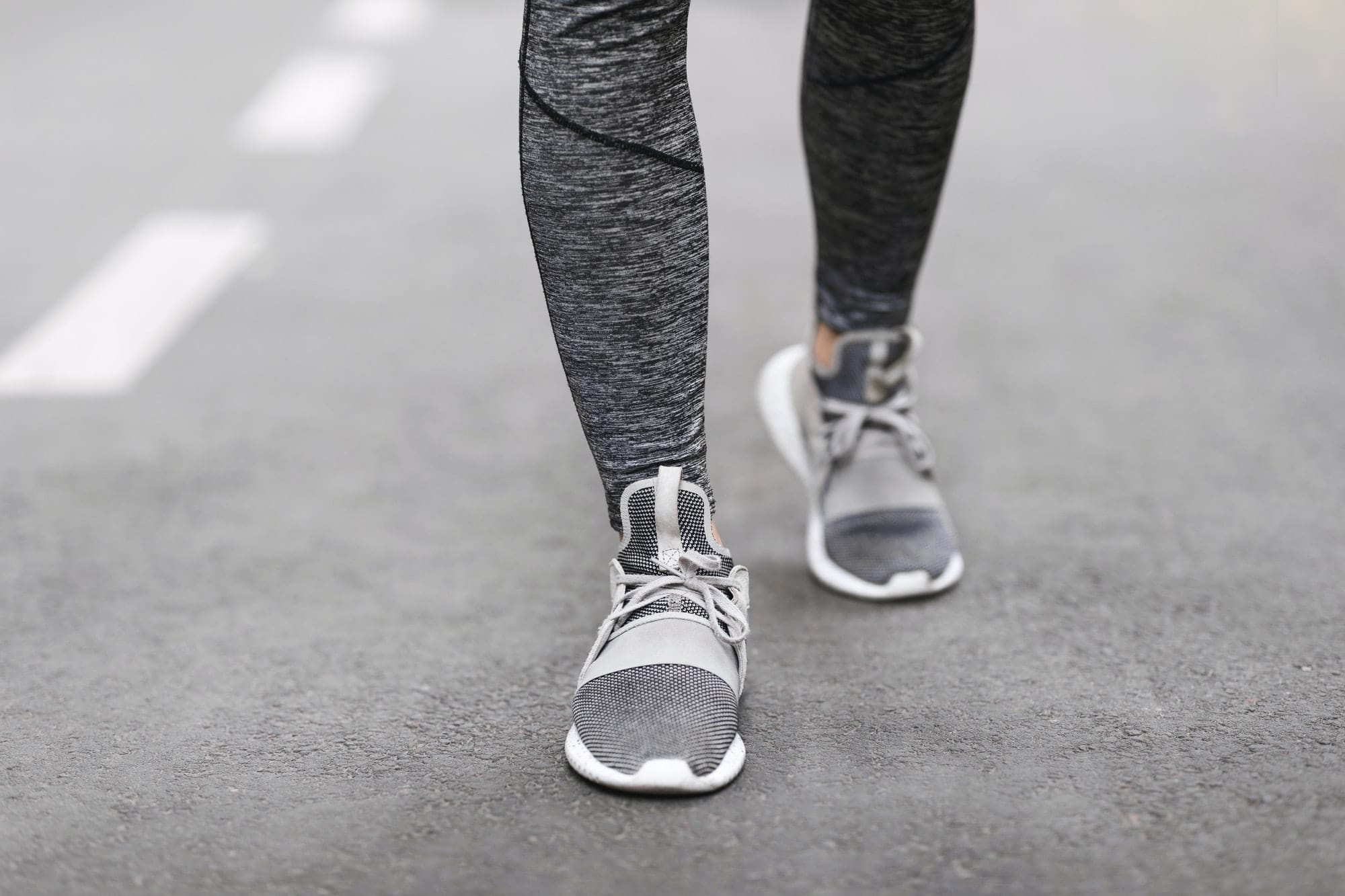 Shoes For Training. Female Legs In Sportswear And Sneakers Walking On Path